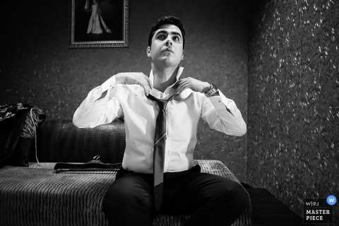 Black and white photo of Istanbul groom getting dressed for wedding | Turkey wedding photography