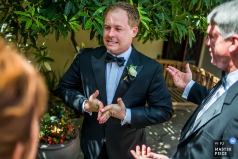 Omaha wedding reception photo of groom looking nervous