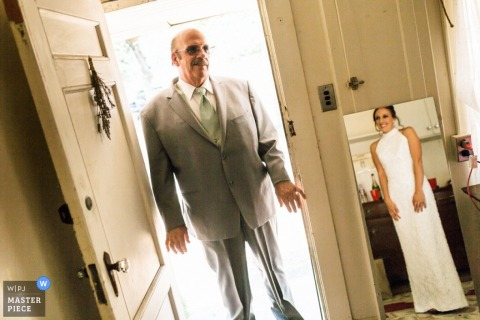 Wedding photograph of dad seeing bride in her dress in San Francisco