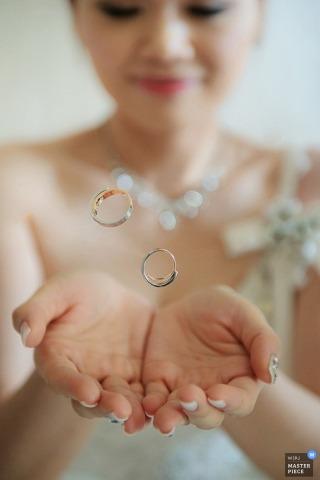 Taipei woman has wedding rings floating in her hands | Taiwan wedding photo
