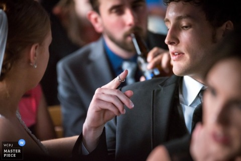 Omaha groom looking at his ring at the reception | Nebraska wedding photo