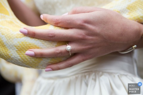 Up close photo of the ring while the bride holds a snake in Kansas | United States wedding photography