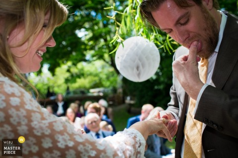 wedding photograph of Noord Holland bride and groom exchanging rings from Amsterdam | wedding ceremony