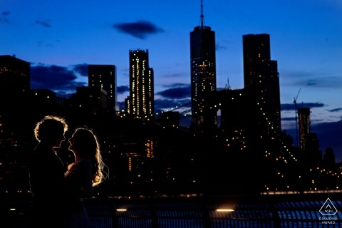 Backlit with rim lighting. Winnipeg Engagement Photo at night in the city.