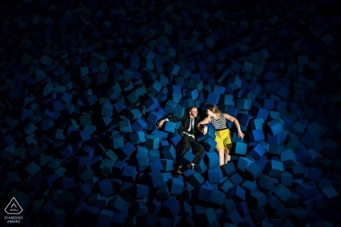 Wedding Engagement Portrait of couple laying in a foam pit | Colorado prewedding sessions