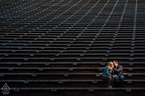Boulder Engagement Photography session on the stadium bleacher seats.