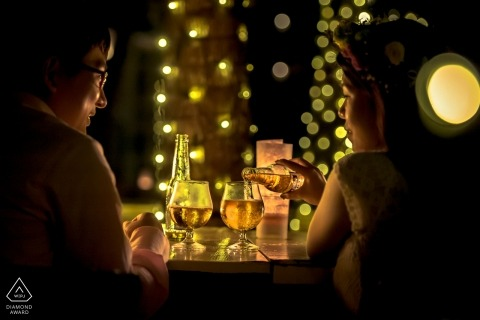 Prewedding portrait of a couple at a restaurant, pouring drinks | Hangzhou City wedding photographer
