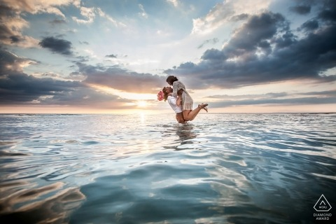 Florida engagement photographer   pre-wedding portrait session at the beach in the water