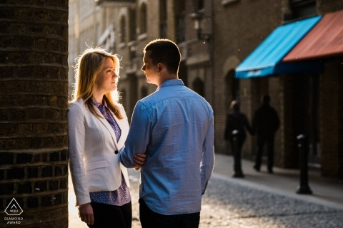 Cobblestone streets and sunlight. London Engagement Photographer