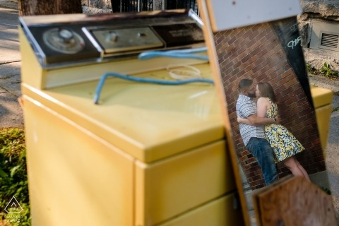 Quebec wedding engagement photos with mirrors and street junk for Montreal couples
