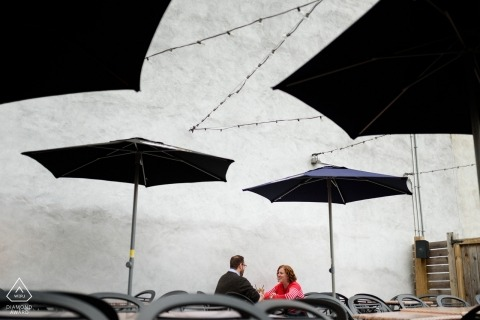Wedding engagement photo at cafe under umbrellas in Montreal | Quebec photography