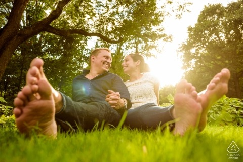 Montreal wedding photo in the grass at the park | Quebec engagement photographers