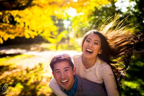 Atlanta, GA Engagement Photography. Piggyback portrait with her hair flying in the sun and wind.