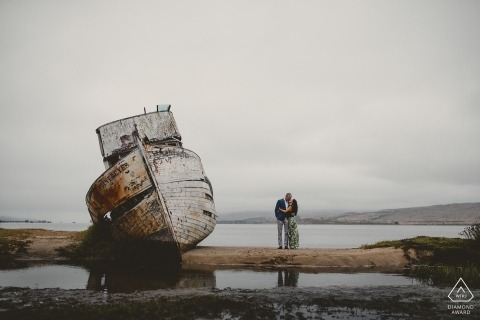 Sacramento Engagement Photographer. Portrait session with a beached and wrecked fishing vessel.