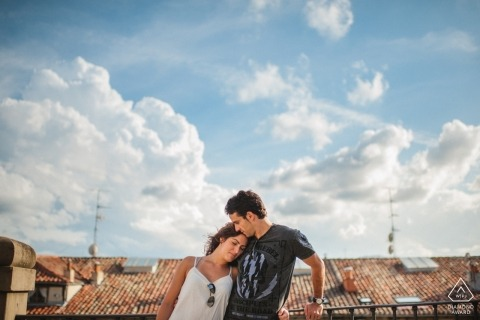 Blue skies and clouds hover overhead during this Biscay engagement photo shoot