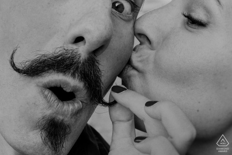 Tightly framed black-and-white portrait of a fun loving couple from Biscay - handlebar mustache photos