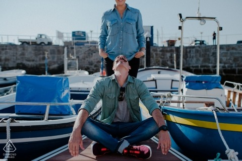 Nautical engagement portrait of a couple at a Biscay Marina with boats