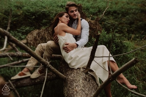 Pre-wedding portrait session in Gipuzkoa | sitting on a downed tree together