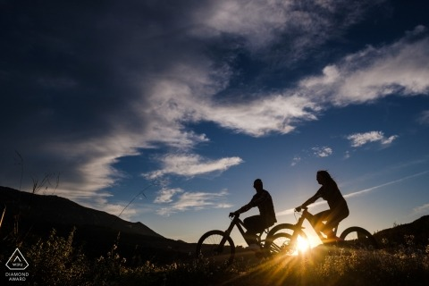 Sunset Mountain bike riding couple by an Alicante Engagement Photographer