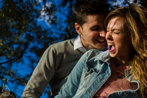 Alicante Engagement Photos. Love and laughter in this warmly lit portrait.