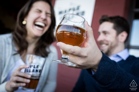 MN Pre Wedding Engagement Photography with a couple having a laugh and some drinks - Minneapolis Photographers