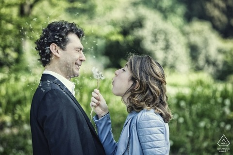 A couple being playful during engagement photo session by Milan wedding photographer
