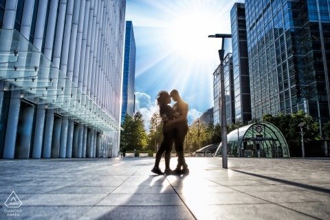 Concrete and glass portrait of a couple. Urban engagement photographer for London