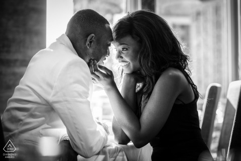 London indoor portrait session for this engaged couple seated inside a coffee shop