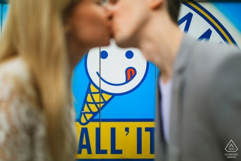 Prewedding portrait of a couple shot in front of ice cream signage | Boston engagement photographer