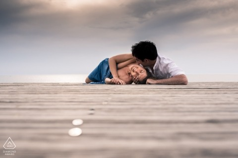 Landes Couple lying on boardwalk in Nouvelle-Aquitaine for their Engagement Photos