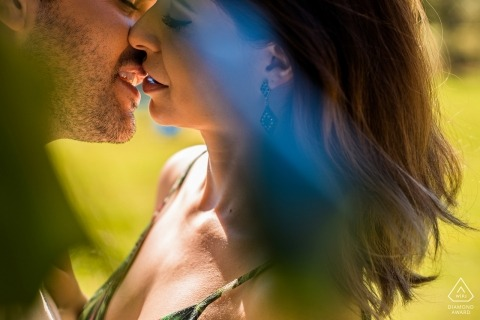 Engaged Brazilian couple kiss in the afternoon sun for their Pre- wedding portrait