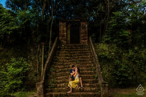 Brazil engagement portraits | sitting on the steps in the forest at the ruins