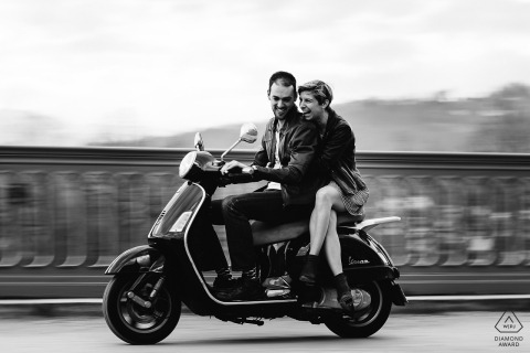 Black and white portraits of a couple in France on a motorbike moped scooter