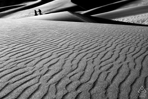 Black and white sand dunes engagement portrait