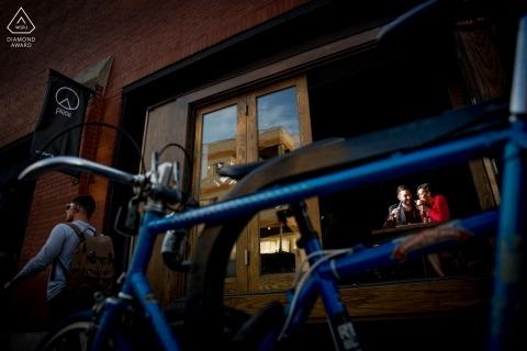 Engagement portrait shot through locked up bikes