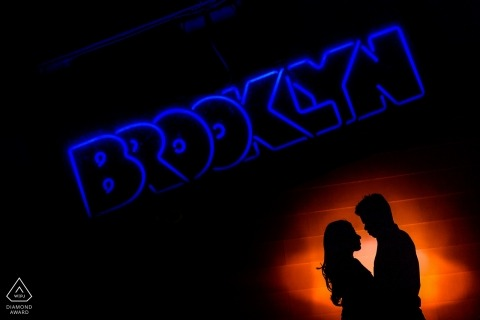 Los Angeles engagement photographer - couple is silhouetted below a Brooklyn sign