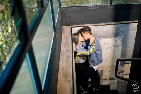 Malaysia pre-wedding couple shoot - newly engaged couple kiss in the stairwell