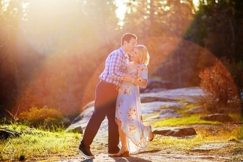 Afternoon engagement portraits in Lake Tahoe - sun flares in the mountains