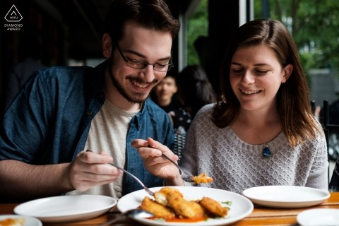 Atlanta Georgia couple share a meal together at a restaurant during their engagement shoot