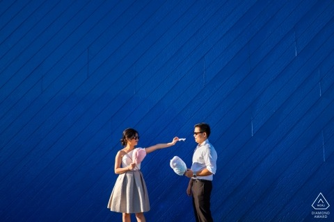 Los Angeles engagement photography - playful couple Sharing blue cotton candy