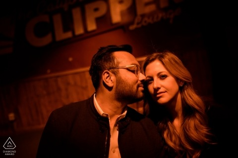 Chicago couple Pose at the bar for their engagement Portrait