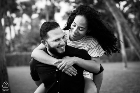 Florida engagement photography | a piggyback ride makes for a fun portrait in Miami