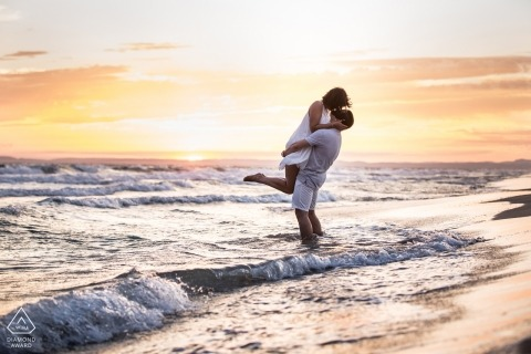 Miami Florida Beach engagement Photos | a couple plays in the small waves at the beach before sunset