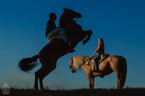 Couple riding horses during portrait shoot | Alicante Engagement Photography