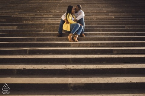 UK pre- wedding portraits - a couple poses in the afternoon sun on concrete steps