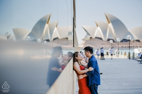 Sydney Opera House engagement portrait with glass reflections.