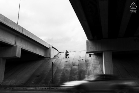 Northern California urban engagement portrait with concrete freeway overpasses
