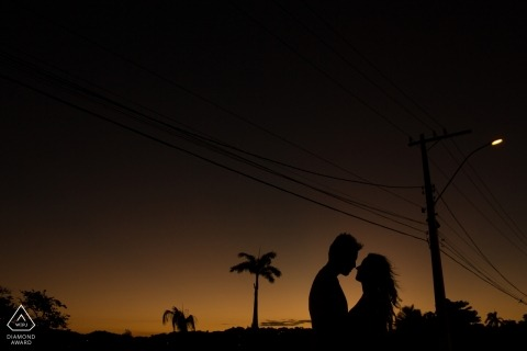 Rio de Janeiro Street lamps and the power poles fill the sky over this silhouetted newly engaged couple during the portrait session