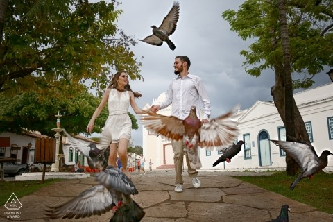 Brazil Engagement Photographer | Couple walking in the park through the birds