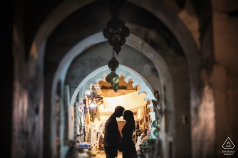 Silhouette couple framed in archways for this Venice engagement portrait